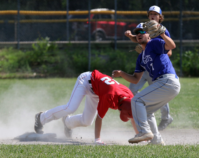Tyngsboro vs Lunenburg baseball.  Lunenburg shortstop Brayden Gendron (7) and second baseman Daniel Wright (11), rear, react as Tyngsboro's Connor St. Gelais (12) is called safe at second with a stolen base in the top of the third inning.  SUN/Julia Malakie