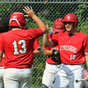 Tyngsboro vs Lunenburg baseball. Tyngsboro's Ryan Wall (13) greets JT Shaffer (10), who scored from second on a double by Ryan Guillmette in the top of the fourth inning. SUN/Julia Malakie