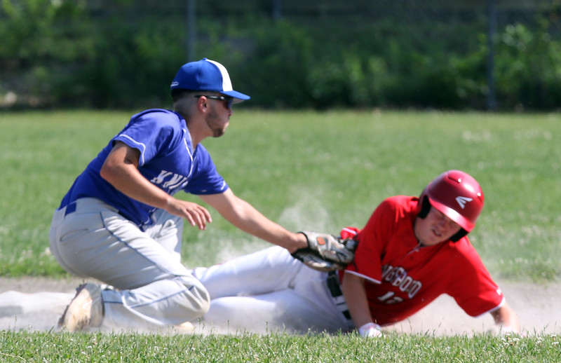 Tyngsboro vs Lunenburg baseball. Tyngsboro's Connor St. Gelais (12) is safe at second with a stolen base as Lunenburg shortstop Brayden Gendron (7) fields the throw. St. Gelais went on to score in the top of the third inning.  SUN/Julia Malakie