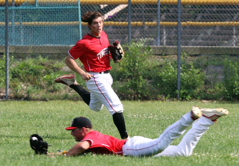 Tyngsboro vs Lunenburg baseball. Tyngsboro right fielder Ryan Guillmette (7) makes a diving catch to end the bottom of the fourth inning. At rear is center fielder JT Shaffer (10). SUN/Julia Malakie