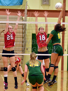 Ursuline's #26 Jillian Lyons and #18 Jessica Hires McKelvey go up to block the ball hit by St. Mark's #8 Lauren Talley during Ursuline's 25-23, 25-18, 25-22 win over St. Mark's at St. Mark's, Thursday, September 29, 2011. photo/Don Blake Photography