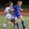 Westford Academy vs Brookline girls soccer in MIAA Division 1 North semifinal. WA's Sacha Pelosky (16) and Brookline's Maya Leschly (17). (SUN/Julia Malakie)