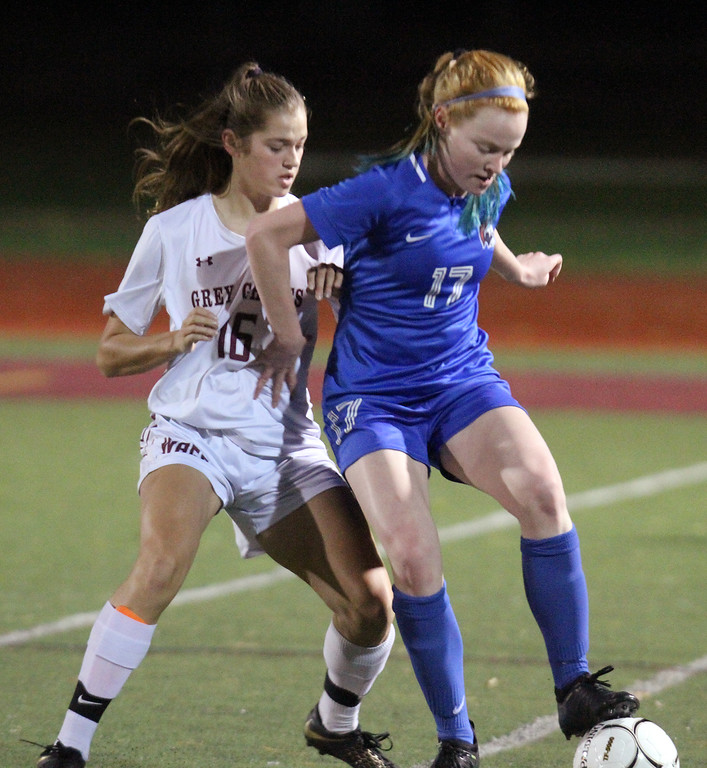. Westford Academy vs Brookline girls soccer in MIAA Division 1 North semifinal. WA\'s Sacha Pelosky (16) and Brookline\'s Maya Leschly (17). (SUN/Julia Malakie)