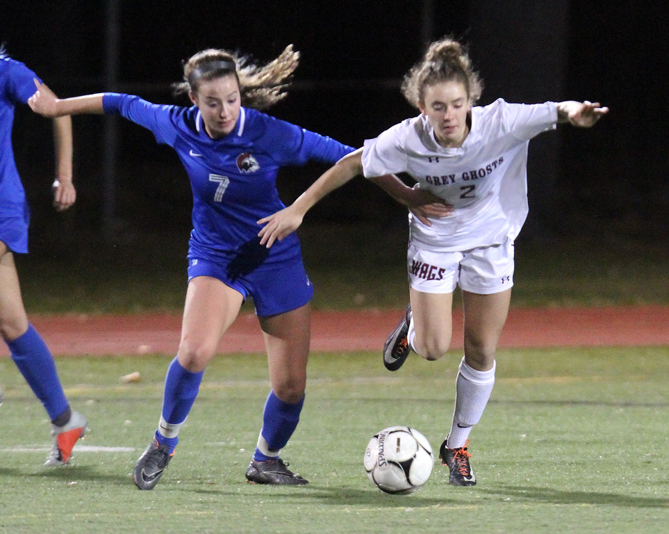 . Westford Academy vs Brookline girls soccer in MIAA Division 1 North semifinal. Brookline\'s Or Yahalom (7) and WA\'s Isabel Doherty (2). (SUN/Julia Malakie)