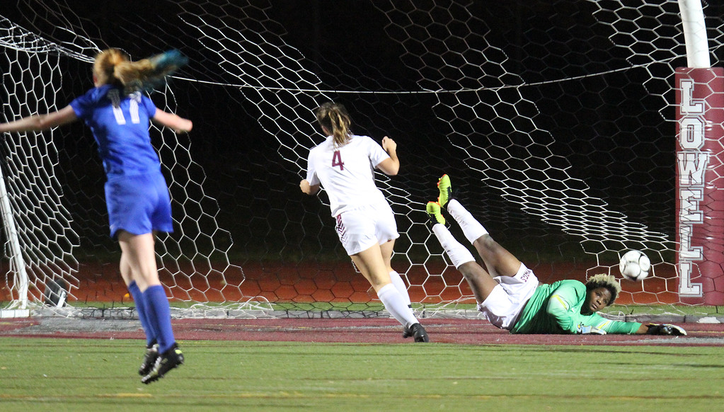 . Westford Academy vs Brookline girls soccer in MIAA Division 1 North semifinal. Shot by Brookline\'s Hallie Friedman (not in photo) gets by WA goalkeeper Mya Barber-Mingo for the first goal of the game. At left are Brookline\'s Maya Leschly (17) and WA\'s Grace Stickel (4). (SUN/Julia Malakie)