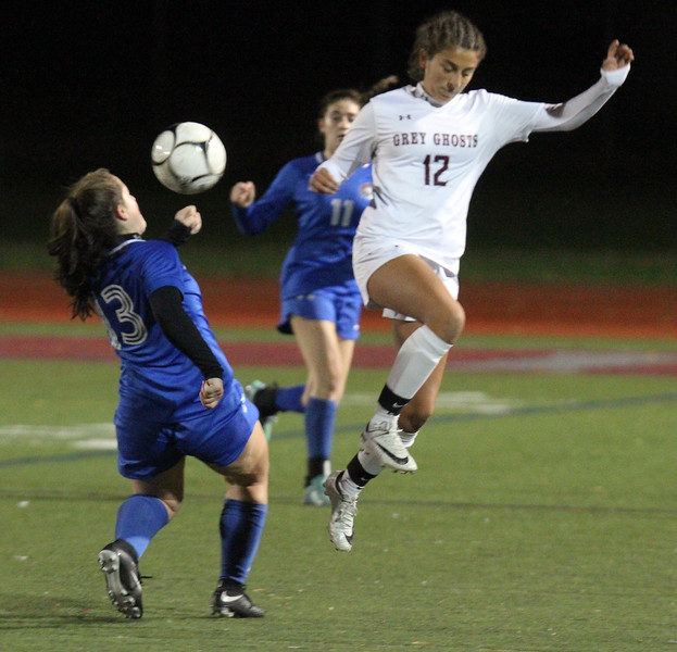 Westford Academy vs Brookline girls soccer in MIAA Division 1 North semifinal. Brookline's Casey Ferrigno (13) and WA's Shadee Saberi (12). (SUN/Julia Malakie)