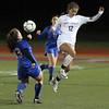 Westford Academy vs Brookline girls soccer in MIAA Division 1 North semifinal. Brookline's Casey Ferrigno (13) and WA's Shadee Saberi (12). (SUN/Julia Malakie)