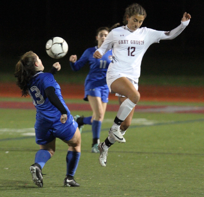 . Westford Academy vs Brookline girls soccer in MIAA Division 1 North semifinal. Brookline\'s Casey Ferrigno (13) and WA\'s Shadee Saberi (12). (SUN/Julia Malakie)