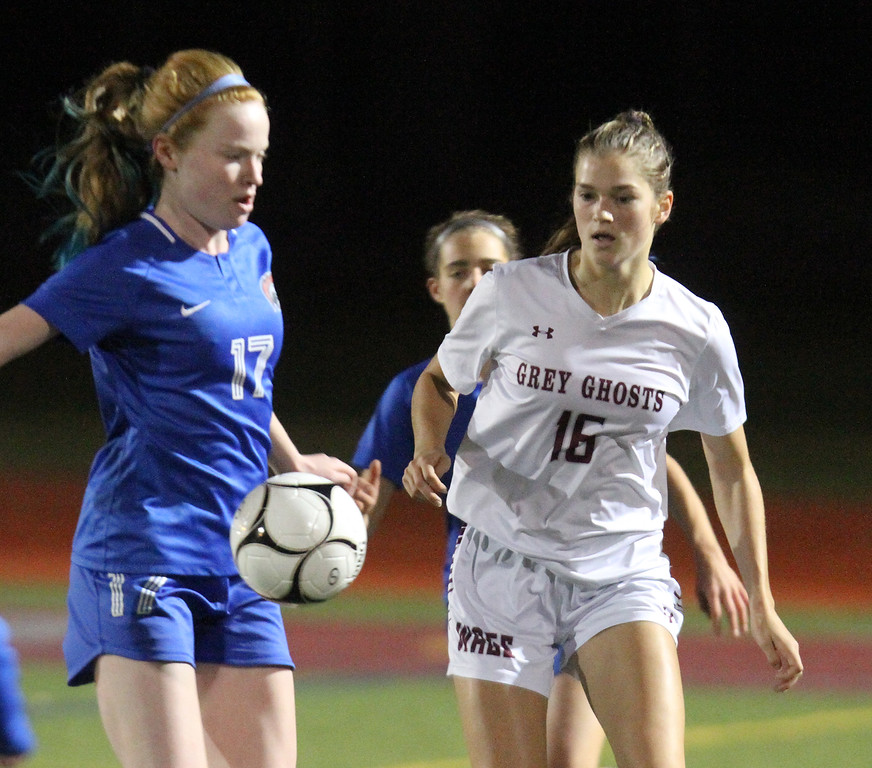 . Westford Academy vs Brookline girls soccer in MIAA Division 1 North semifinal. Brookline\'s Maya Leschly (17) and WA\'s Sacha Pelosky (16). (SUN/Julia Malakie)