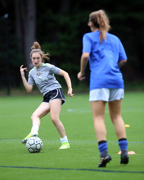 Westford Academy girls soccer practice at Nutting Fields. Victoria Princi, left, and Kelly Mammola, during passing drills. (SUN/Julia Malakie)