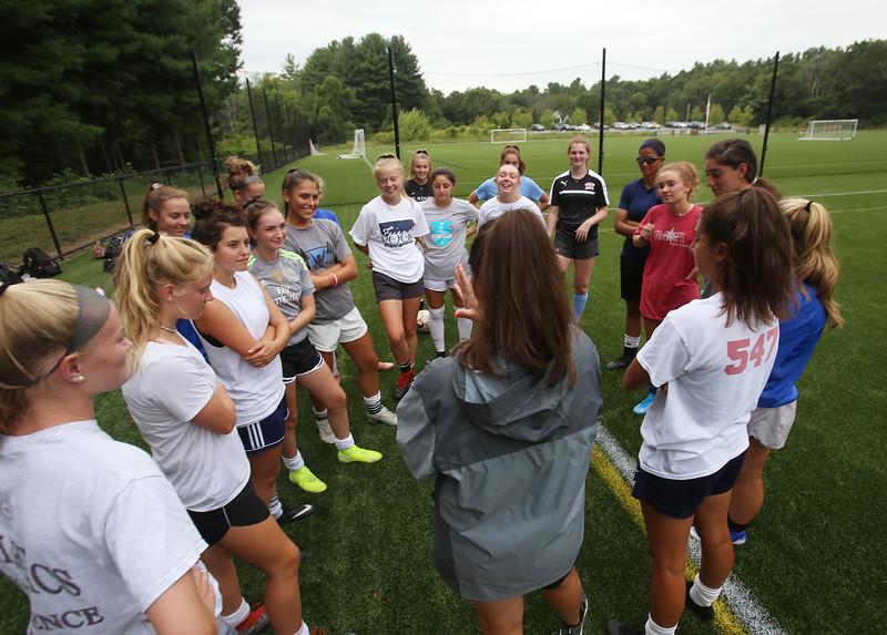 Westford Academy girls soccer practice at Nutting Fields. Coach Katie Andjus talks to the team. (SUN/Julia Malakie)