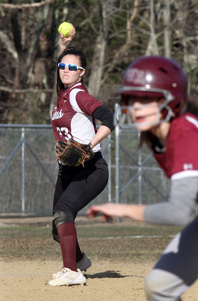Westford Academy vs Chelmsford softball. Chelmsford shortstop Meghan Goode (23) throws to first catching Westford pinch runner Danielle Mitrano (3) off base in the bottom of the fourth inning. (SUN/Julia Malakie)