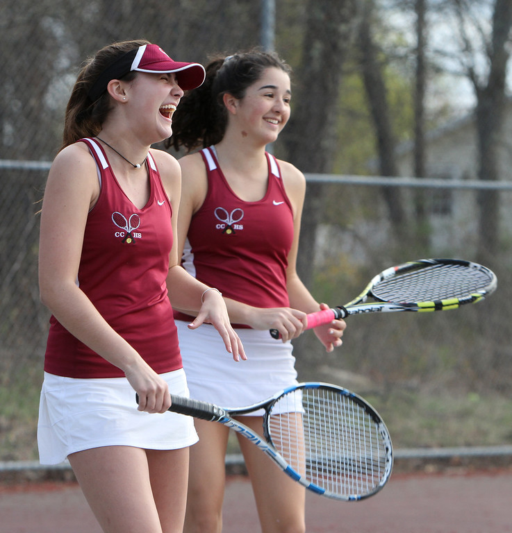 . Westford Academy vs Concord-Carlisle girls tennis. Concord-Carlisle\'s Caitlin McCarthy, left, and Lillian Keefe react after a point in their 2nd Doubles match. (SUN/Julia Malakie)