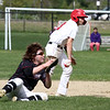 Tyngsboro vs Groton-Dunstable baseball. Tyngsboro baserunner Chris Ausiello (9) is caught in a rundown as Groton-Dunstable first baseman Kasey Griffiths (9) prepares to throw to first with the pitcher covering in the bottom of the first inning. (SUN/Julia Malakie)