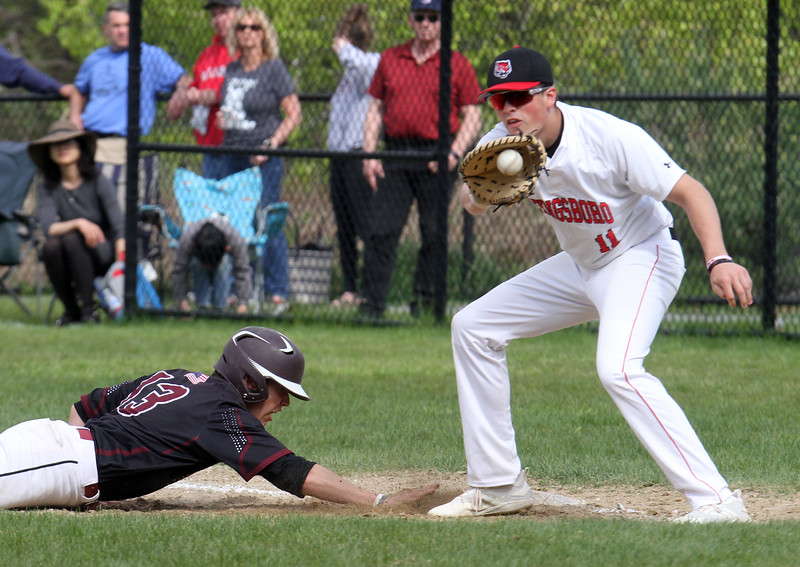 Tyngsboro vs Groton-Dunstable baseball. Groton-Dunstable's Doug Tompkins (13) dives back safely to first as Tyngsboro first baseman Phil Sutherland (11) fields the throw in the top of the second inning. (SUN/Julia Malakie)