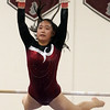 Westford Academy vs Groton-Dunstable gymnastics. Hannah Wang of Westford Academy on bars.  (SUN/Julia Malakie)
