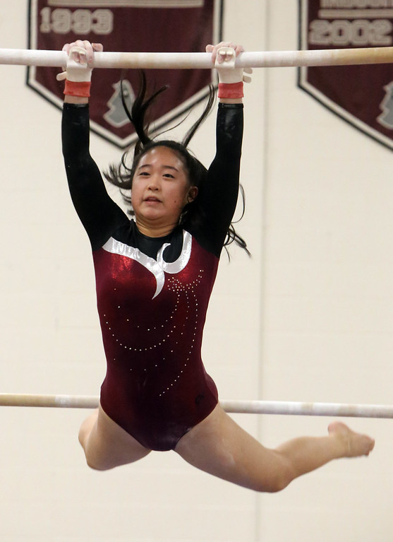 . Westford Academy vs Groton-Dunstable gymnastics. Hannah Wang of Westford Academy on bars.  (SUN/Julia Malakie)