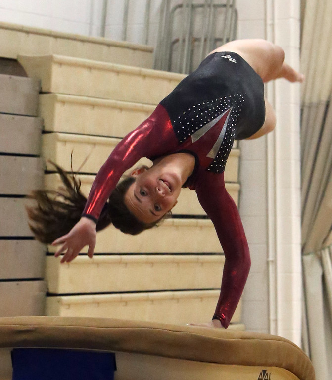 . Westford Academy vs Groton-Dunstable gymnastics. Sarah Bushnell of Groton-Dunstable on vault. (SUN/Julia Malakie)