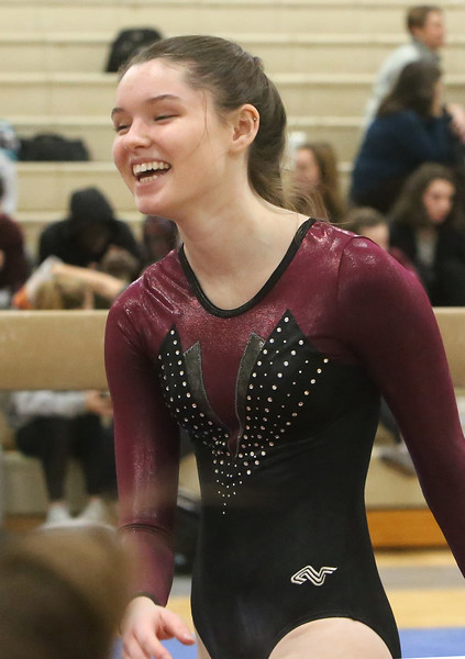 Westford Academy vs Groton-Dunstable gymnastics. Tori Gromann of Groton-Dunstable reacts after finishing beam. (SUN/Julia Malakie)