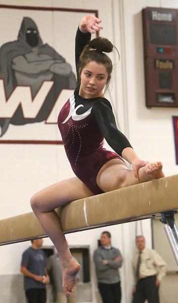 Westford Academy vs Groton-Dunstable gymnastics. Jelina Farrell of Westford Academy on beam.  (SUN/Julia Malakie)