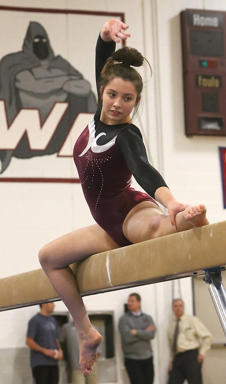 . Westford Academy vs Groton-Dunstable gymnastics. Jelina Farrell of Westford Academy on beam.  (SUN/Julia Malakie)