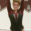 Westford Academy vs Groton-Dunstable gymnastics. Erin Woodle of Groton-Dunstable on bars. (SUN/Julia Malakie)