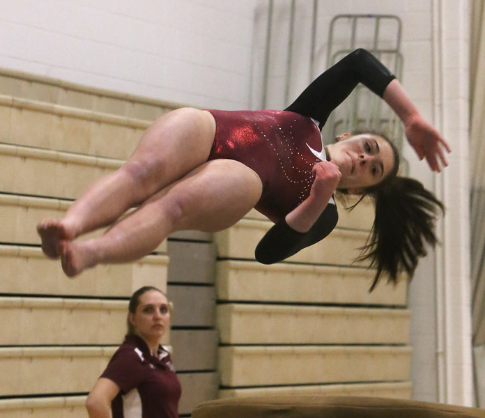 Westford Academy vs Groton-Dunstable gymnastics. Jess Gould of Westford Academy on vault. (SUN/Julia Malakie)