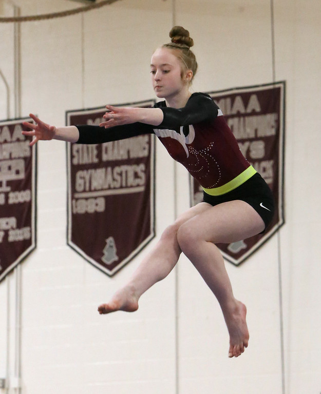 . Westford Academy vs Groton-Dunstable gymnastics.  Erin Cragg of Westford Academy on beam. (SUN/Julia Malakie)