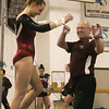 "Westford Academy vs Groton-Dunstable gymnastics. Grace Keele of Westford Academy and coach Tom Bonacci react after she finished her bars routine with a ""giants"" on the third try. (SUN/Julia Malakie)"