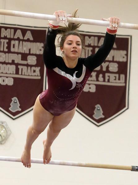 Westford Academy vs Groton-Dunstable gymnastics. Jelina Farrell of Westford Academy on bars. (SUN/Julia Malakie)