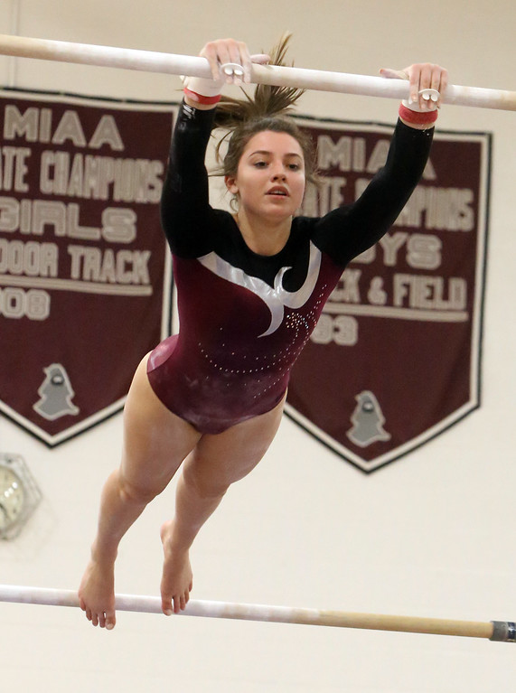 . Westford Academy vs Groton-Dunstable gymnastics. Jelina Farrell of Westford Academy on bars. (SUN/Julia Malakie)