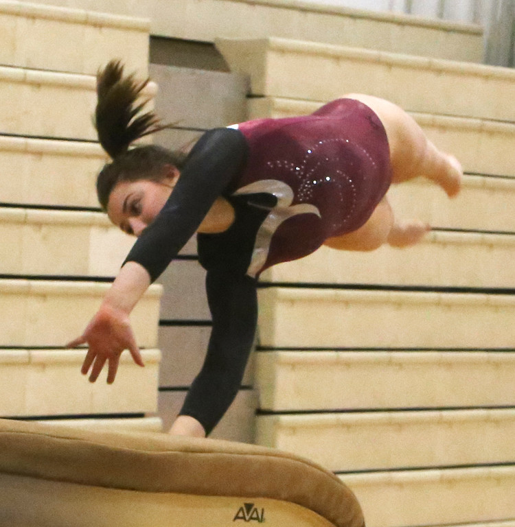 . Westford Academy vs Groton-Dunstable gymnastics. Jelina Farrell of Westford Academy on vault. (SUN/Julia Malakie)