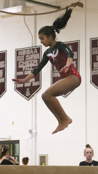 Westford Academy vs Groton-Dunstable gymnastics. Trisha Chittu of Westford Academy on beam.  (SUN/Julia Malakie)