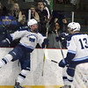 Wilmington vs Wakefield boys hockey. Wilmington's Zachary Kincaid (9), left, bounces off the glass to celebrate his goal in the second period, with teammate Joseph Hill (13). (SUN/Julia Malakie)