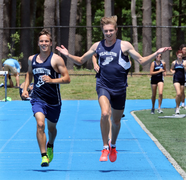 """Wilmington vs Stoneham track & field.  Wilmington's Owen Surette, left, and Sean Riley finish together winning the boy's Mile. Surette said """"we were going to win as a team. We didn't tell that to coach, though."""" SUN/Julia Malakie"""