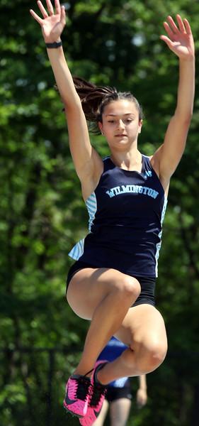 Wilmington vs Stoneham track & field.  Wilmington's Mollie Osgood competes in long jump. SUN/Julia Malakie
