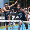 Wilmington vs Stoneham track & field. Wilmington's Sam Juergens, left, who finished second, and Nehemiah Camara, who won, in the 110M Hurdles.  SUN/Julia Malakie