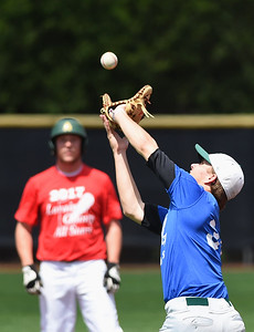 KRISTIN BAUER | CHRONICLE Elyria Catholic High School's Jeff Spencer (38) catches a popfly during the Lorain County All Star baseball game on Saturday afternoon, May 27.