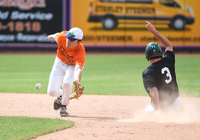 KRISTIN BAUER | CHRONICLE Avon High School's second baseman Matt Kelly (4) catches a throw and narrowly misses tagging out Brady Thompson (3) during the Northeast Ohio Baseball Coaches Association's annual All-Star Game on Tuesday afternoon, June 20.