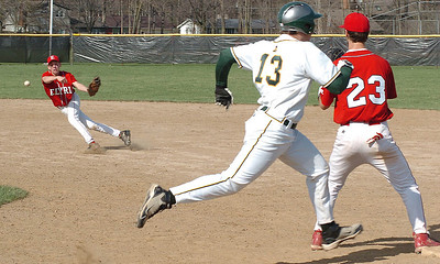 Bottom of 1st - Amherst's #13 Marcus Rivera  reaches 1st base as  Elyria's #6 throws to Elyria's 1st baseman #23