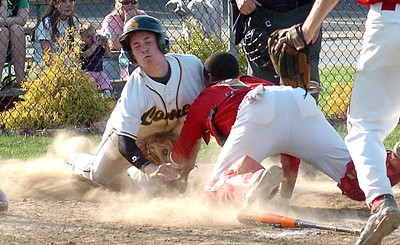 Bottom of 4th - Amherst's #7 Xavier Bonilla is out at home as Elyria's catcher #4 tags him before he can touch home plate.