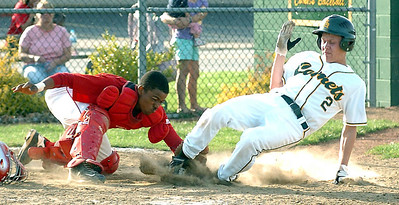 Bottom of 5th - Elyria's catcher #4 tags out amherst's #2 Austin Waits as he tries to cross home plate.