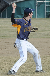 North Ridgeville's Austin Leininger throws to first. STEVE MANHEIM/CHRONICLE
