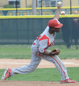 Jamaris Cook pitches for Elyria against Amherst on May 11.  STEVE MANHEIM/CHRONICLE