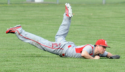 Elyria's Carlos Lopez makes a diving outfield catch May 11.  STEVE MANHEIM/CHRONICLE