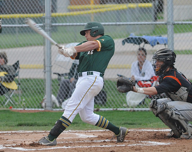 Amherst's Mark Harris singles in the first inning May 1.  STEVE MANHEIM / CHRONICLE