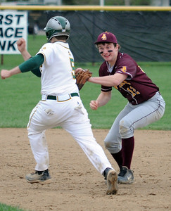 Avon Lake Matt Kohler tags out Amherst Andy Dito at second base in fourth inning Apr. 28.  Steve Manheim
