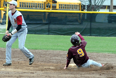 Avon Lake Alex Dillon steals second base before the throw to Brecksville Kyle Coronel in second inning Apr. 20.  Steve Manheim