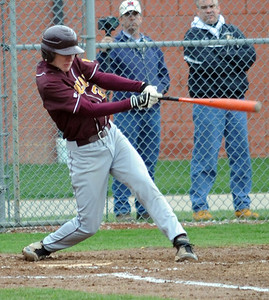 Avon Lake Ryan Rodgers hits an RBI triple in first inning Apr. 20.  Steve Manheim