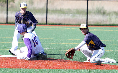 ANNA NORRIS/CHRONICLE Avon's Ryan Socha slides safe into second base on a steal before North Ridgeville's Cody Reffert can make the catch and the tag in the third inning Sunday afternoon at Sandusky Sports Park.